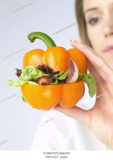 Woman with pepper vegetable-burger