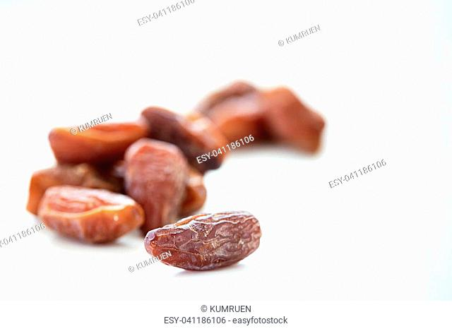 Heap of dried date fruit isolated on white