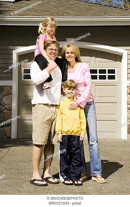 Family portrait in driveway