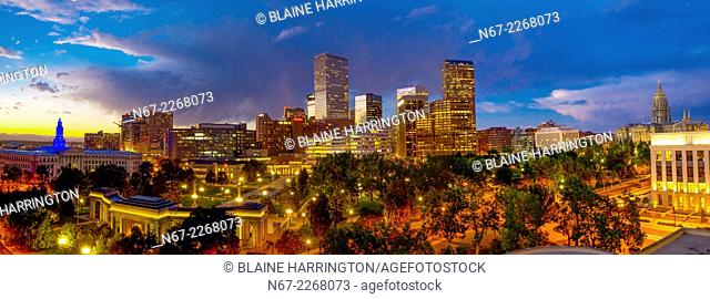 Panoramic view of downtown skyline with City & County Building on left, Civic Center Park in foreground and Colorado State Capitol on right, Denver
