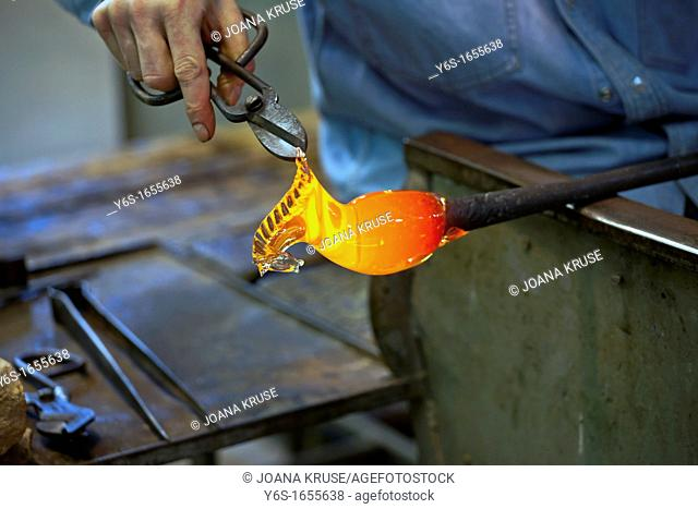 Art glass blower from Murano forms a figure