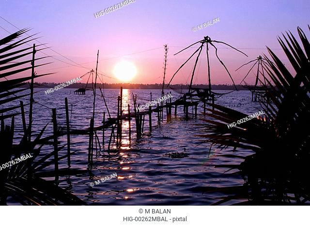 SUNSET NEAR CHINESE NETS IN KUMBALANGHI MODEL TOURISM VILLAGE NEAR KOCHI