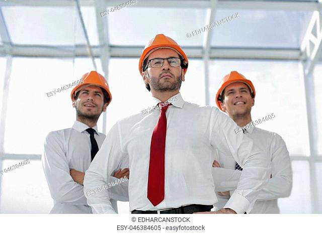 close up.architect and business group standing in the office.business concept