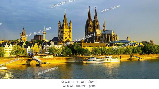 Germany, Cologne, View to Townhall, Colonius, Great St Martin, Cologne Cathedral, Old town riverside, Rhine river in the evening