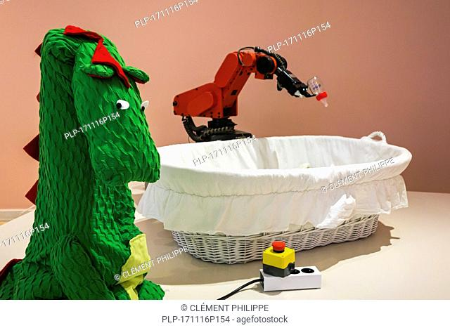 Robot Baby Feeder, kill switch to deactivate robot and dragon costume to make industrial robots more approachable