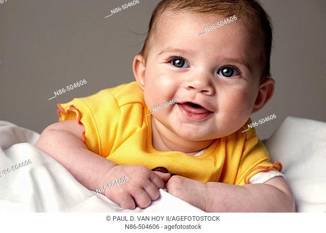 Little baby smiling in studio