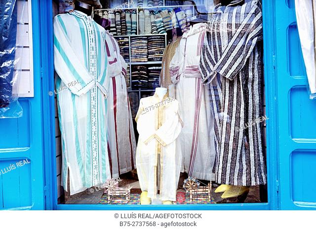 Djellabas in shop window. Clothing store, Chauen, Morocco