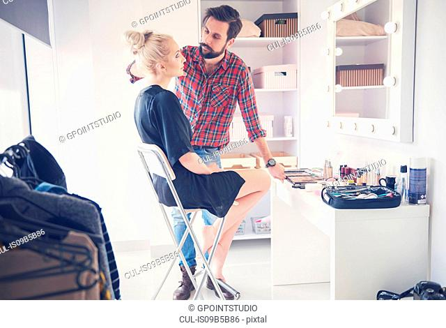 Male make up artist and model getting ready for photo shoot