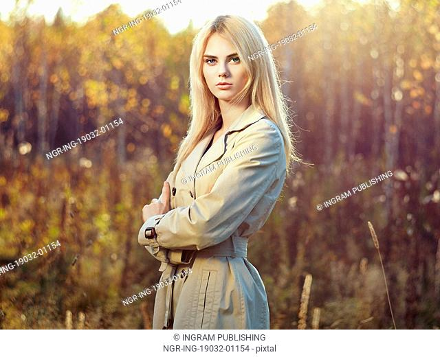 Portrait of young beautiful woman in autumn cloak. Fashion photo. Blonde girl. Perfect make-up