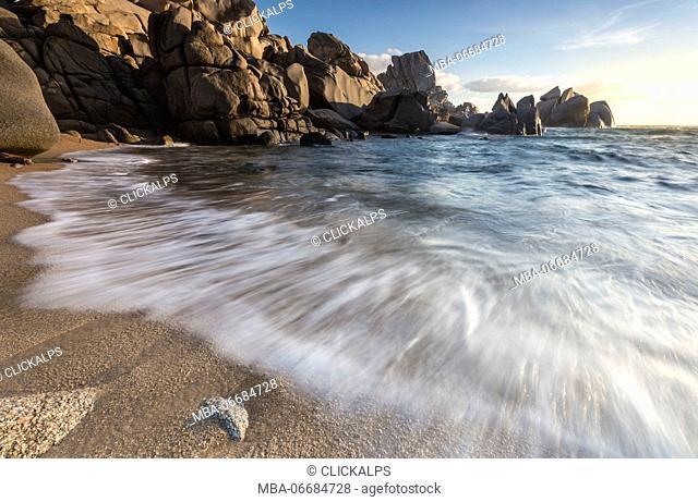 Waves crashing on the sandy beach framed by cliffs Capo Testa Santa Teresa di Gallura Province of Sassari Sardinia Italy Europe