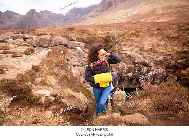 Mid adult woman hiking, Fairy Pools, Isle of Skye, Hebrides, Scotland