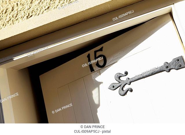 Front door, open ajar, number fifteen