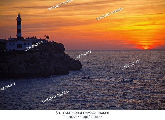 Harbour entrance, Far de Sa Punta de Ses Crestes, lighthouse on the rocky coast near Porto Colom, sunset, Felanitx, Majorca, Balearic islands, Spain