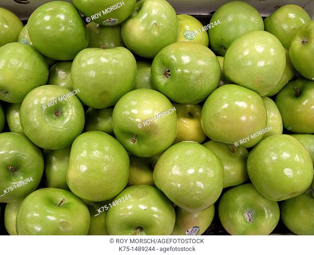 Display of green apples