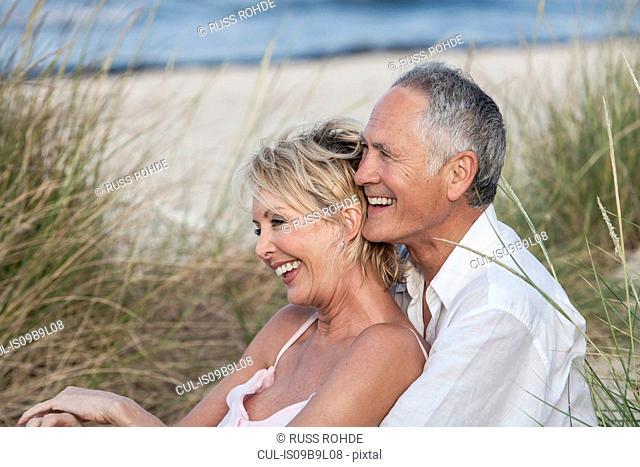 Couple hugging on beach, Palma de Mallorca, Spain