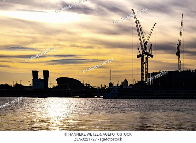 Amsterdam skyline with a construction site at sunset, The Netherlands, Europe