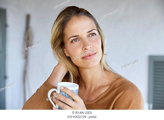 Serene woman drinking coffee