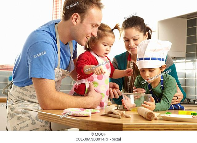 Young family cooking together in kichen