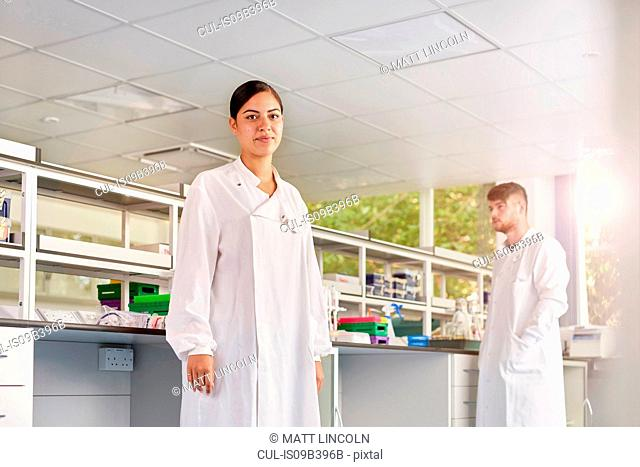 Scientist in laboratory looking at camera