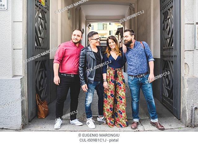 Group of friends in front of building entrance