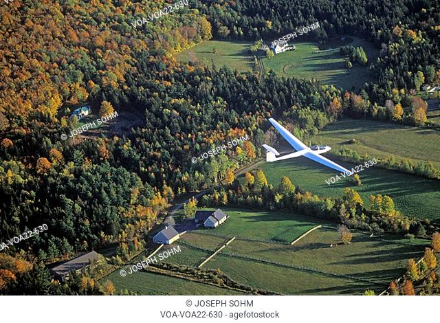An aerial glider flies over Warren, Vermont in autumn