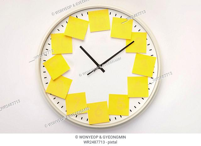 Clock with yellow post-it on each number