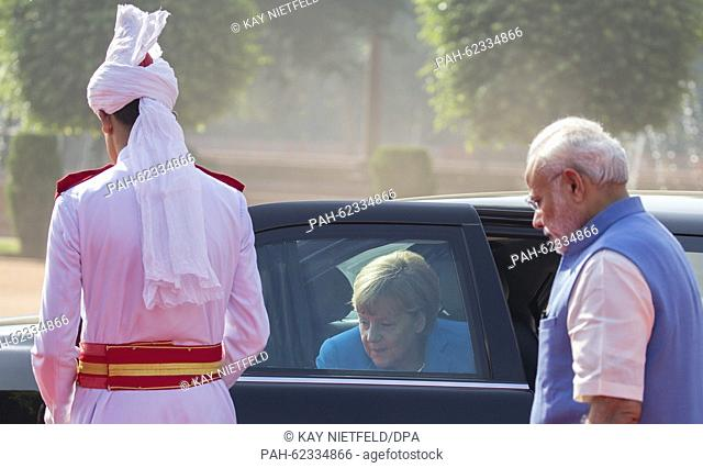 German Chancellor Angela Merkel is received by Indian Prime Minister Narendra Modi (R) in New Dehli, India, 05 October 2015