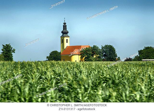 Onion domed church in the middle of a farmer's field seen in Hungary