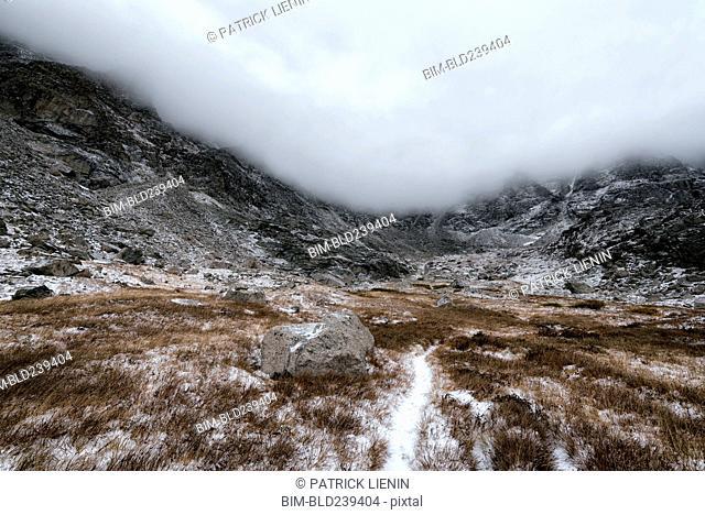 Clouds over rocky landscape
