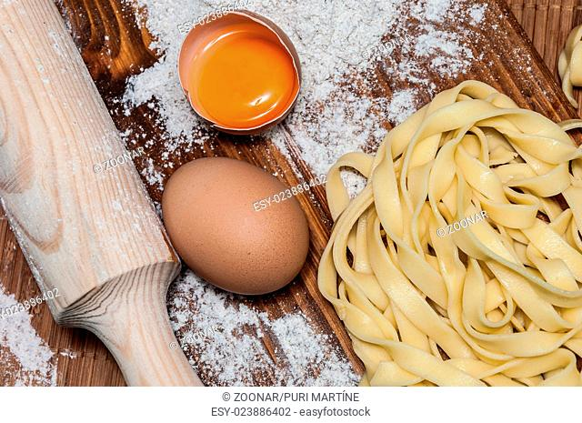 Homemade tagliatelle, eggs and rolling pin
