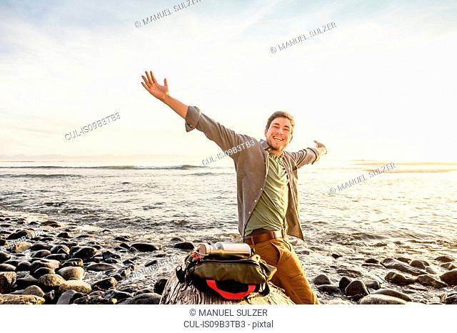 Portrait of happy man on beach in Juan de Fuca Provincial Park, Vancouver Island, British Columbia, Canada