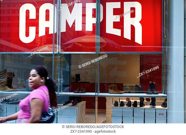 Camper Store shoes in New York. Manhattan. Girls window shopping at a Camper shoes shop in. USA. Camper opened its second location—the flagship store—in 2009