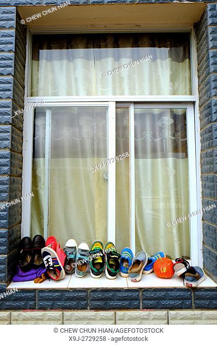 Outside the house, shoe and Window