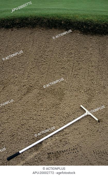 Rake in a golf course sand bunker