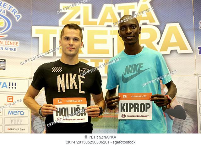 From left Czech sprinter Jakub Holusa and Kenyan runner Asbel Kiprop pose for photo with their starting number during the news conference to the IAAF World...