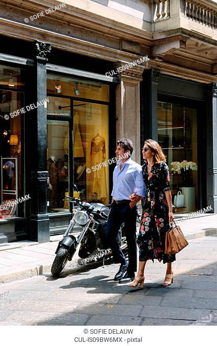 Couple enjoying leisurely walk, Milan, Italy