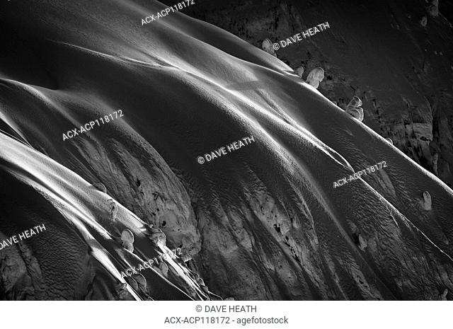 Detail of smooth snow on Ymir Mountain in Black and white at Whitewater ski area, BC, Canada