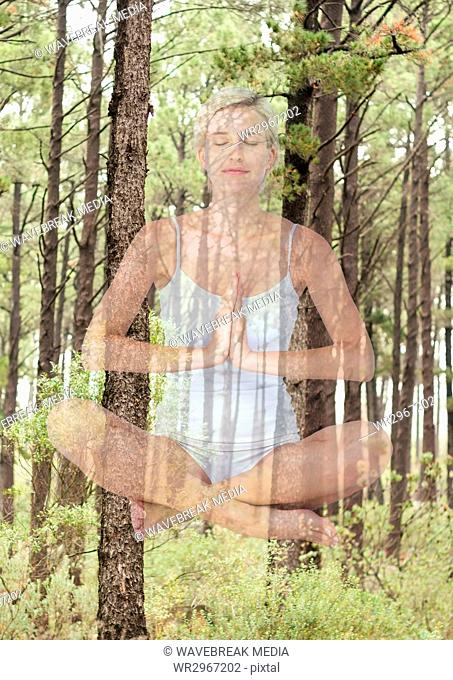 Woman doing yoga in front of wood