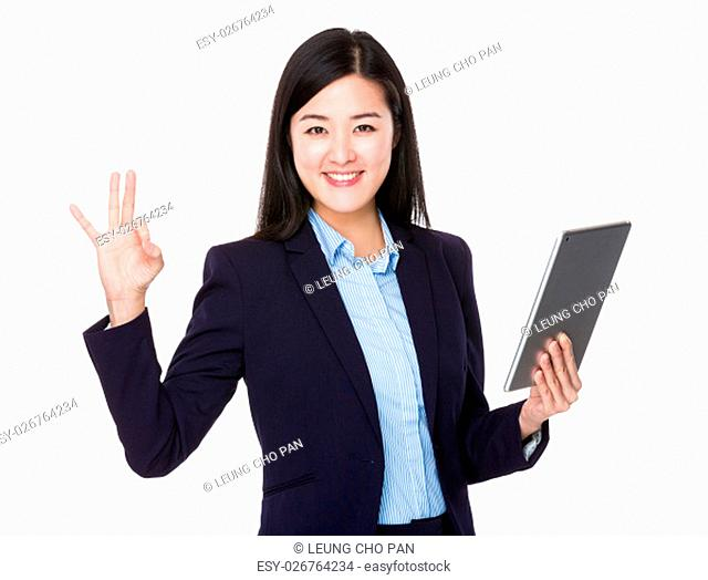 Young businesswoman hold with tablet