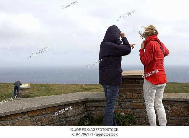 tourists at windy observation point on dunnet head most northerly point of mainland britain scotland uk