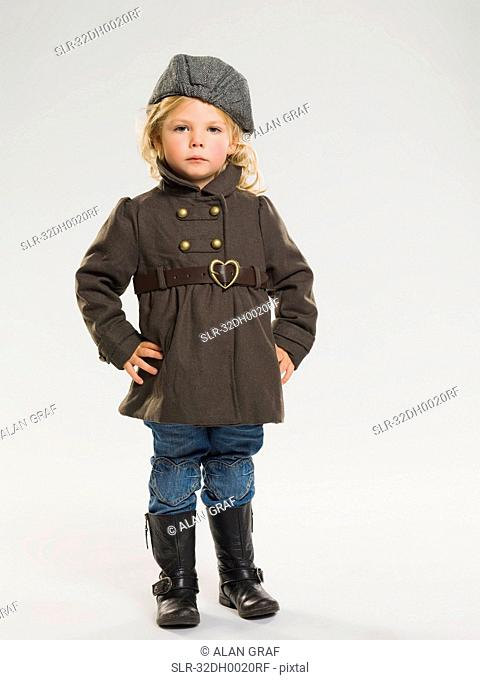 Girl wearing coat and rainboots