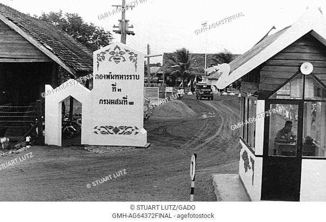 Entrance to Vietnamese army post, covered guard box, with guard, in the foreground, Vietnam, 1964