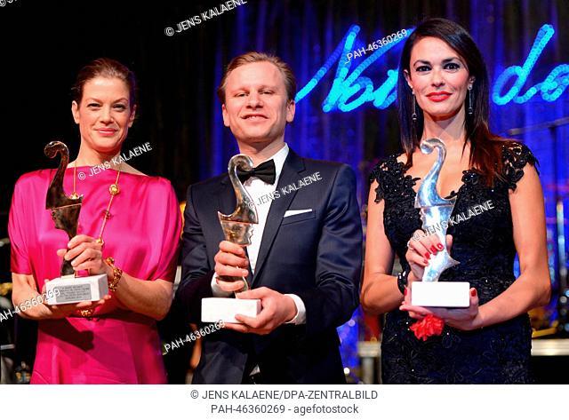 The laureates (L-R), German actress Marie Baeumer, Austrian actor Robert Stadlober and Italian actress Maria Grazia Cucinotta hold their Premio Bacco trophies...