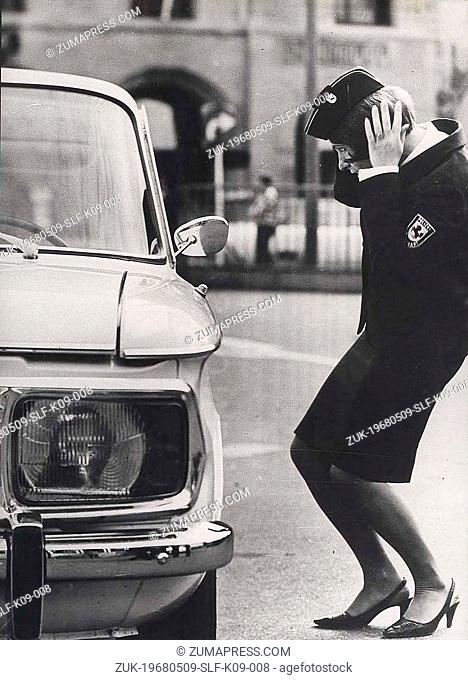 May 09, 1968 - Berlin, Germany - Policewoman fixing her hat while on break from directing traffic.(Credit Image: © Keystone Press Agency/Keystone USA via...