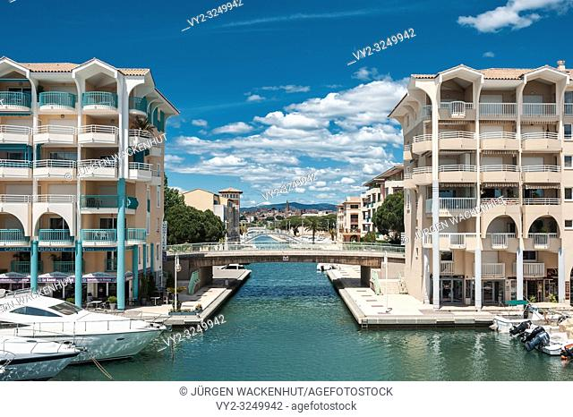 Marina of Port Frejus with old town in background, Fréjus, Var, Provence-Alpes-Cote d`Azur, France, Europe