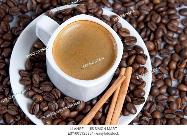Espresso over coffe beans