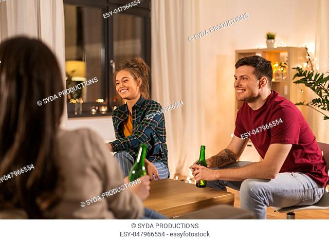 friends drinking non-alcoholic beer at home
