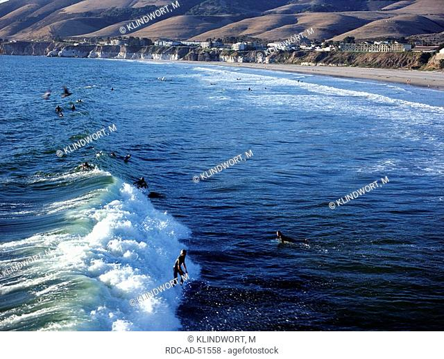 Surfer in the surf at the beach of Pismo Beach Highway One California USA