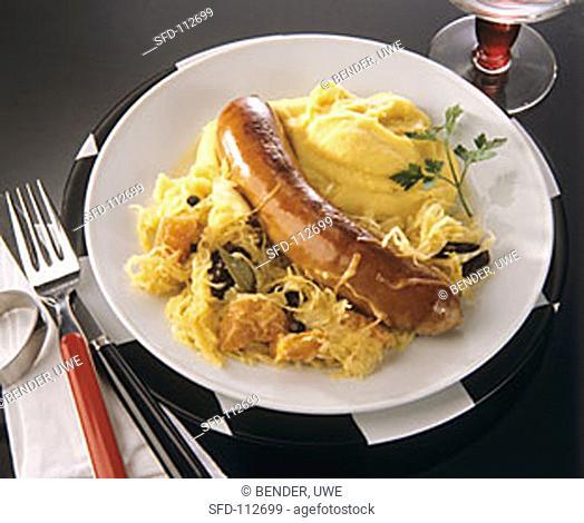 One sausage with mashed potato and sauerkraut