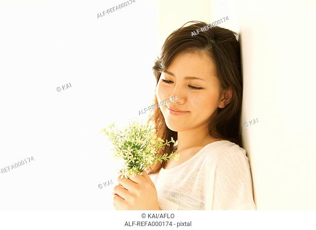 Young woman with flowers smiling